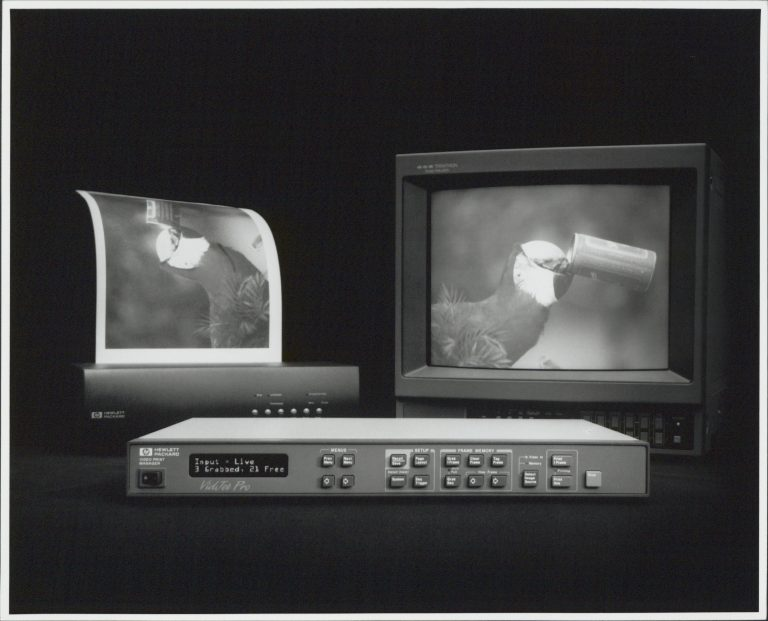 A photo of Hewlett-Packard's VidJet Pro system with video monitor and HP printer.