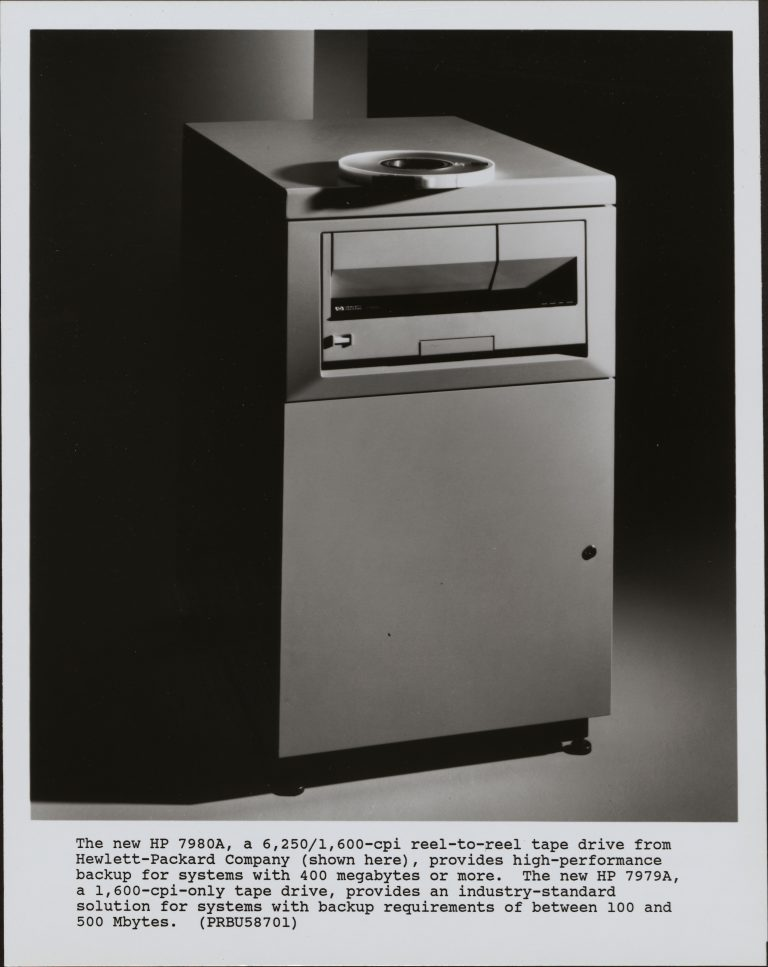 Photo of the HP 7980A data backup system with a typed product description underneath from 1988.