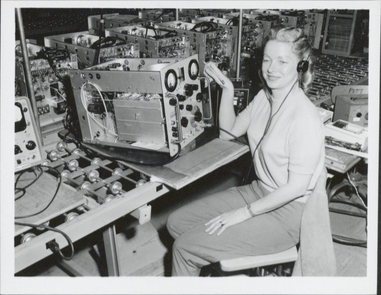 A photo of Ercil Joseph calibrating Hewlett-Packard's 608 signal generator.