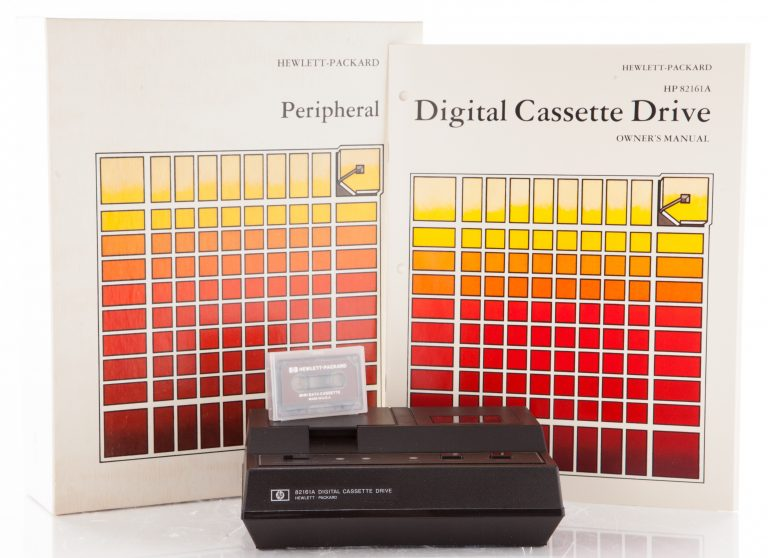 HP 82161 Digital Cassette Drive with cassette, packaging and owner's manual.
