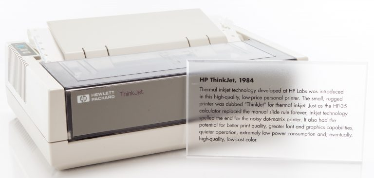 Photo of the HP 2225 ThinkJet printer with a clear plastic plaque describing the device.