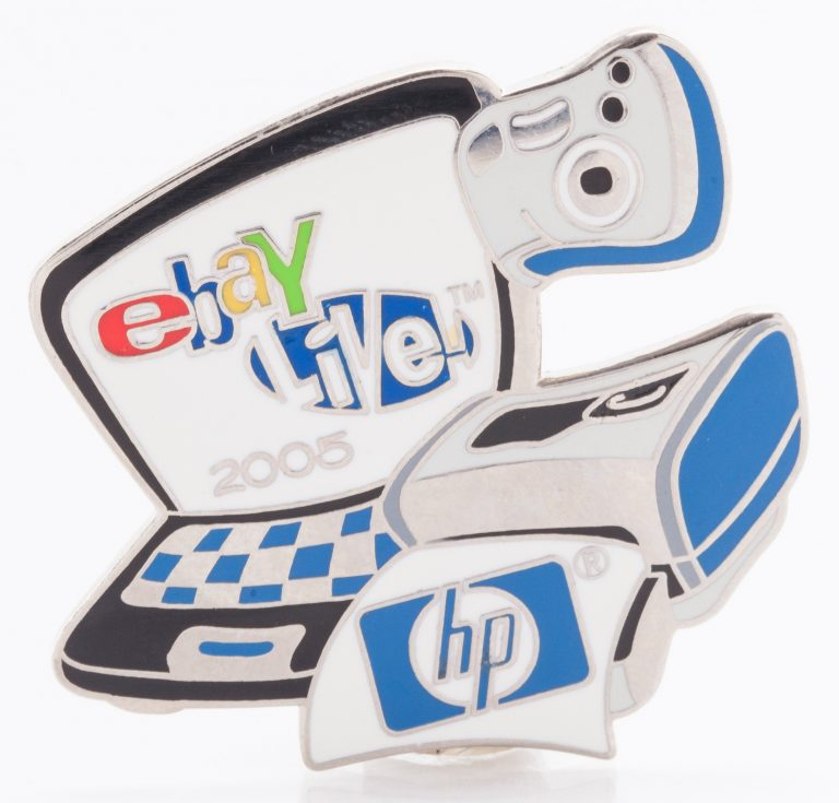 A pin celebrating HP's sponsorship of eBay Live! in 2005, featuring a laptop, printer and camera.