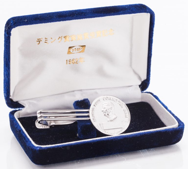 Deming Prize tie clip in its case.