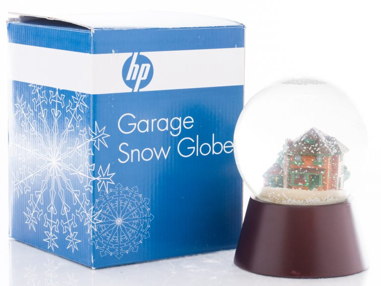 The Garage Snow Globe featuring the Addison Avenue property including the garage, house & shed.