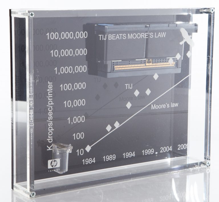 A display piece showcasing how HP's improvements in printing speed and precision exceeded Moore's Law.