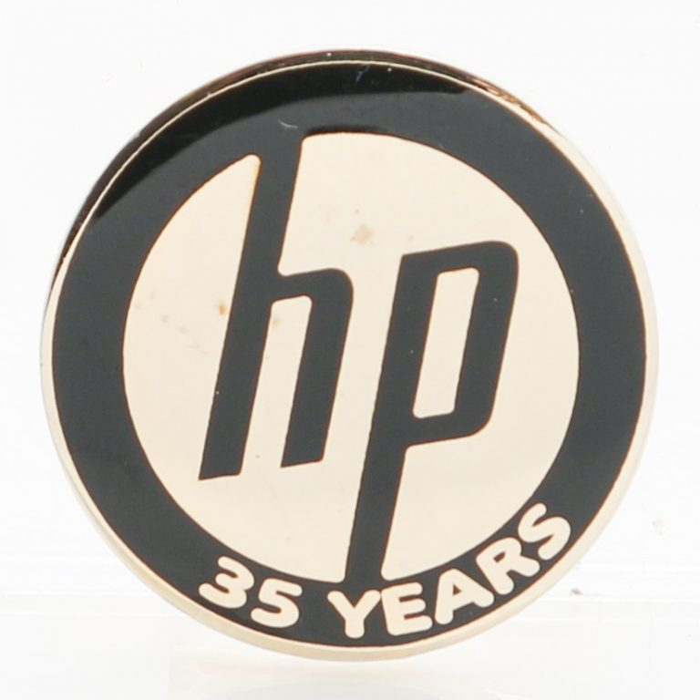 Hewlett-Packard pin given for 35 years of service to the company. The black and gold pin reads