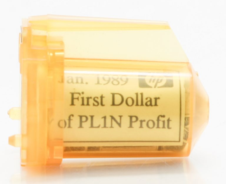 An unused inkjet cartridge holding the first dollar Hewlett-Packard's PL1N line brought in.