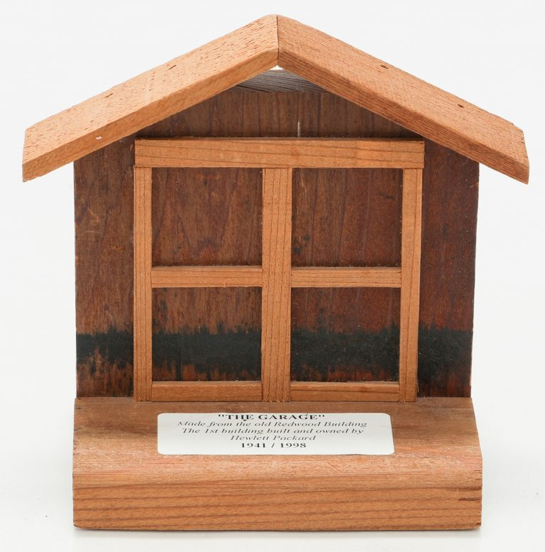A miniature representation of the Addison Avenue garage made from wood reclaimed from HP's Redwood Building.