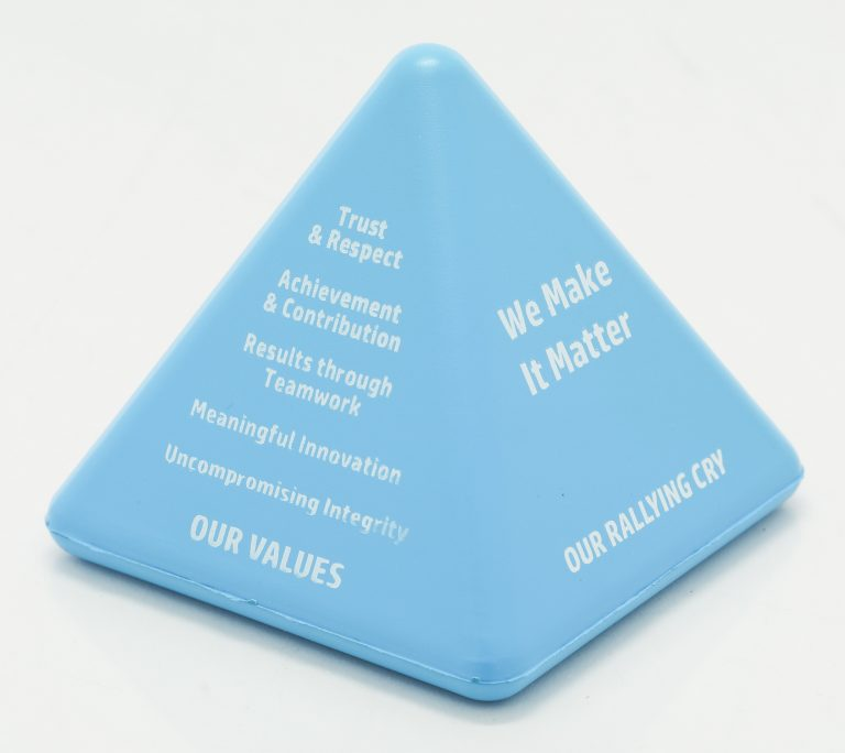A foam toy shaped like a pyramid. One side has the company values and the other has HP's rallying cry, We Make It Matter.