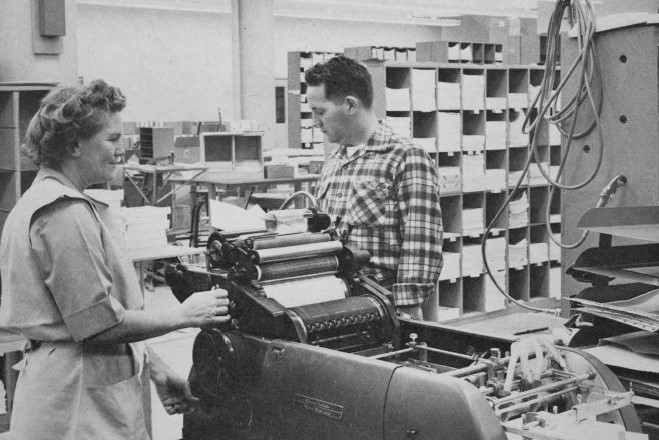 The cover of Watt's Current from January 1961 with Patrica Vogt & Wally Brann working on a Dressagraph Multilift Model 1275.