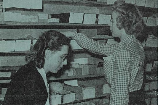 Cover of Watt's Current from May 24, 1946 featuring Billie Howard and Marge Normal working in the stockroom.