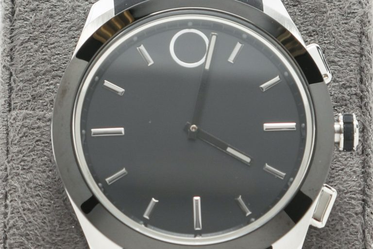 The Movado Bold Series watch with black face and straps and silver-colored accents and frame.
