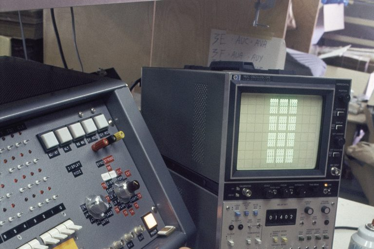Photo of the HP 1601L Logic Analyzer with various wires attached.