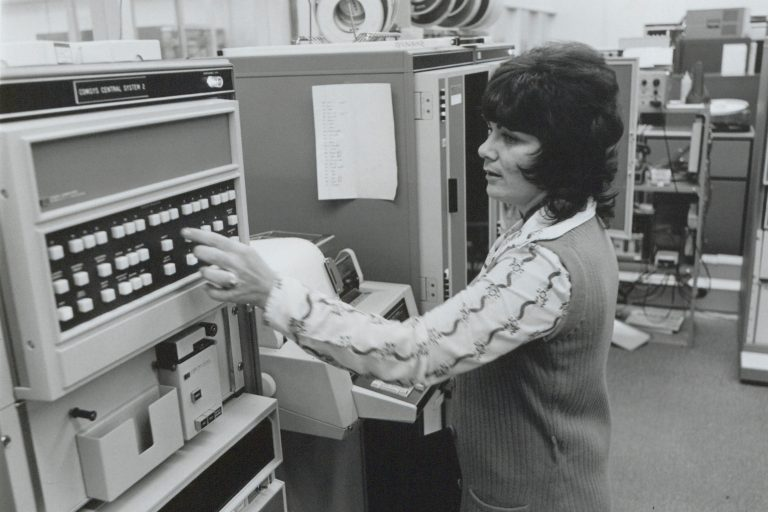 A woman working on the Comsys system used to communicate with HP facilities all over the globe in 1974.