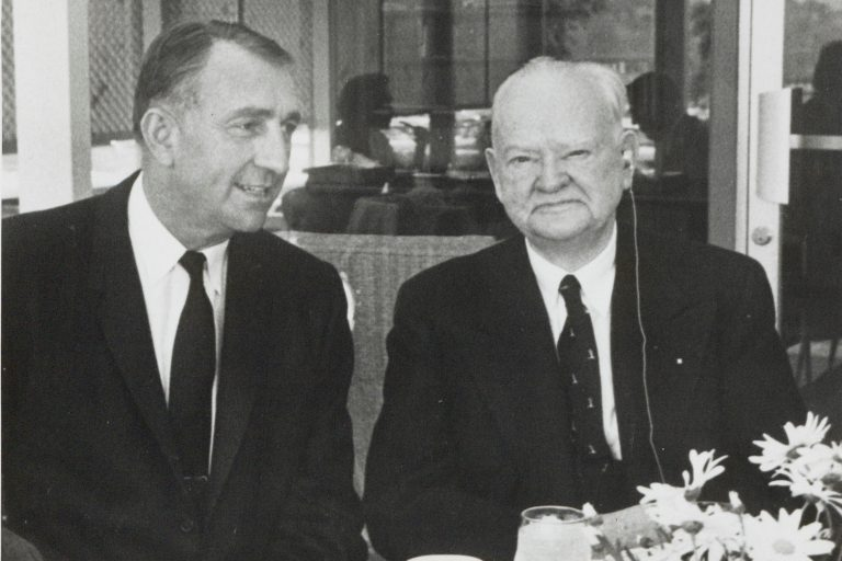 Dave Packard seated next to former US President Herbert Hoover in 1960.
