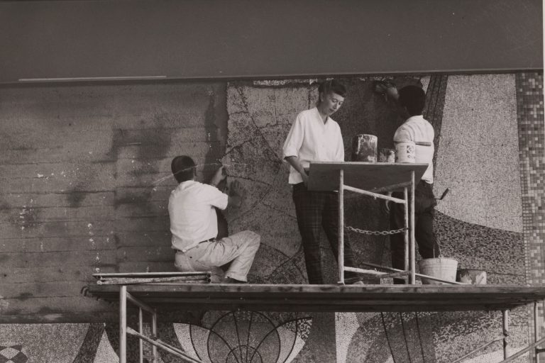 Mary Henry and two others installing a mosaic at the front entrance of 1501 Page Mill Road in 1960.