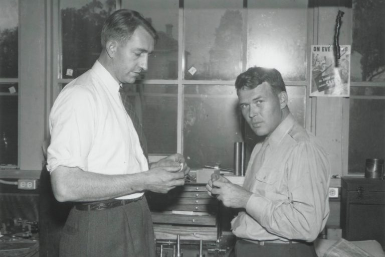 Photo of Dave Packard and Bill Hewlett working at a workbench in the 1940s.