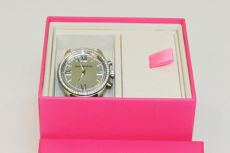Photo of Isaac Mizrahi smartwatch featuring HP technology and Swarovski crystals in a pink display box.