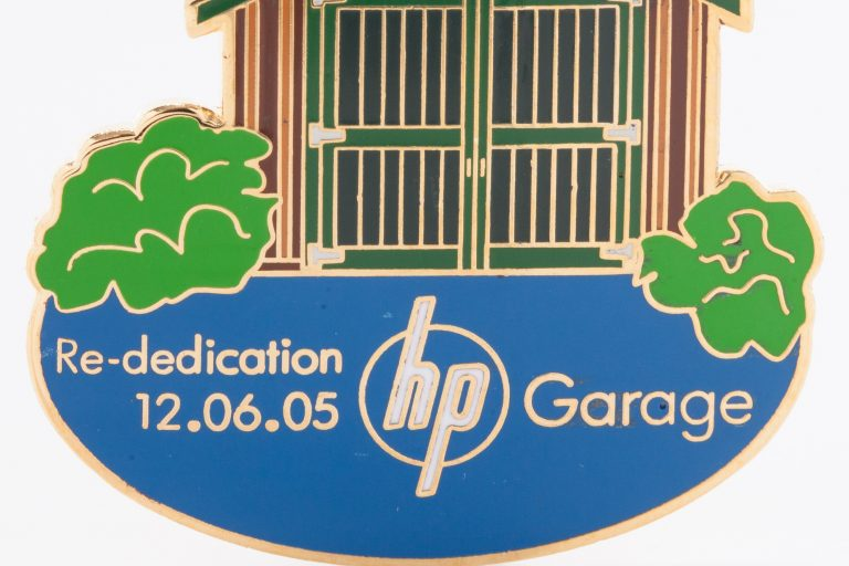 Commemorative pin depicting the Addison Avenue garage and reading Re-dedication 12.05.05 hp garage.