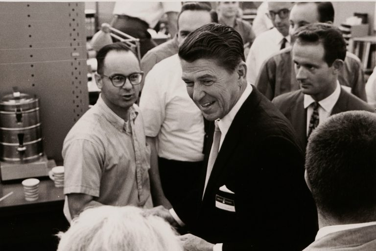 A photo of Ronald Reagan speaking with employees during his visit to Hewlett-Packard in 1966