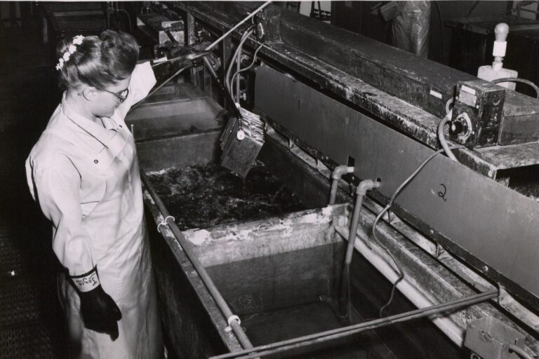 A woman etching circuits at the Palo Alto facility in the 1950s or 1960s.