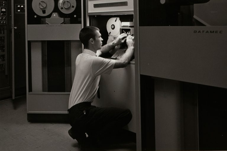 Man works on the SC4400 magnetic tape recorder.