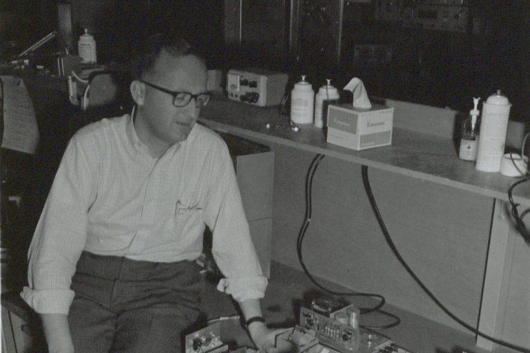 Fred Johnstone next to a breadboard emulator in 1967.