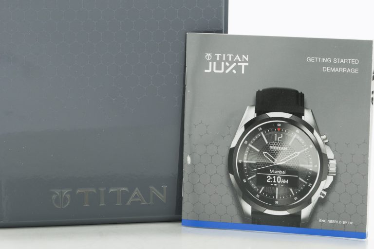 Box and manual for the Titan Juxt wristwatch engineered by HP.