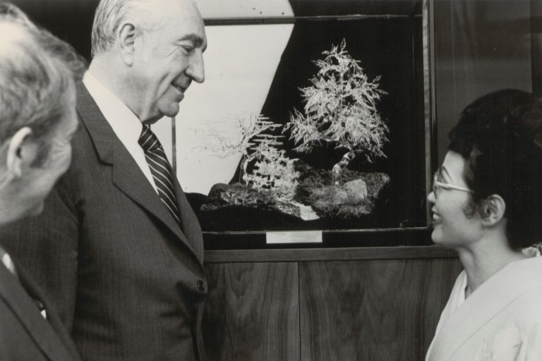 Kyoko Sagimori of Hewlett-Packard's Santa Clara division speaks with Dave and Bill in front of the glass bonsai tree.
