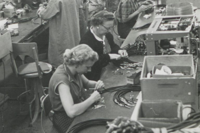 Photo of many women on Hewlett-Packard's production line in the 1940s or 1950s.