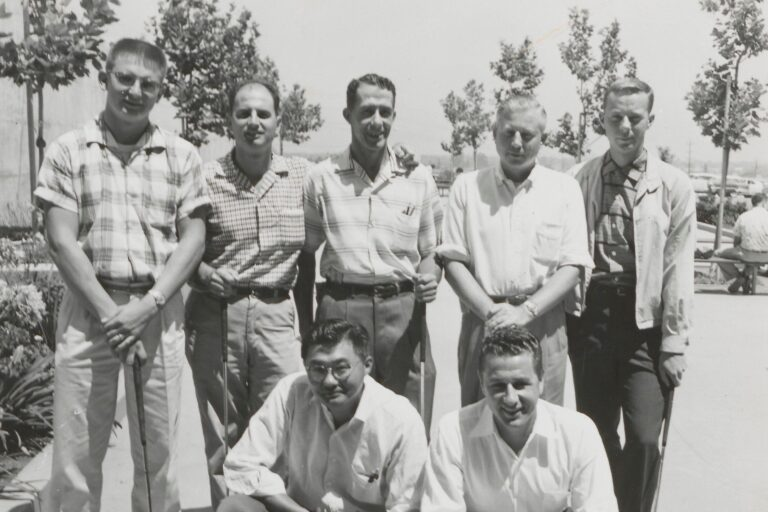 A group of HP employees including Yas Shimoguchi (left foreground), reportedly the first Japanese American ever hired by HP.
