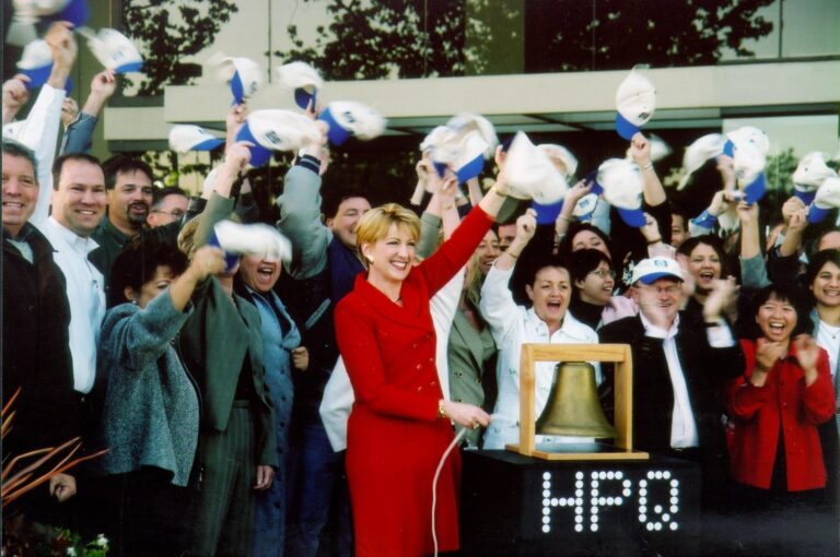 Carly Fiorina rings the bell to open the NYSE after acquiring Compaq.