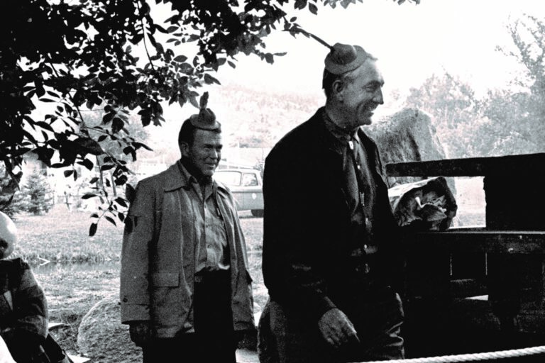 Bill Hewlett and Dave Packard wearing tiny hats during a skit at the dedication of HP Loveland in 1962.
