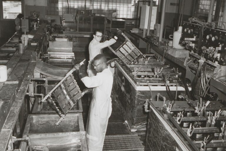 Two HP employees in Palo Alto dip-soldering circuits in the Palo Alto production facility in the 1950s.