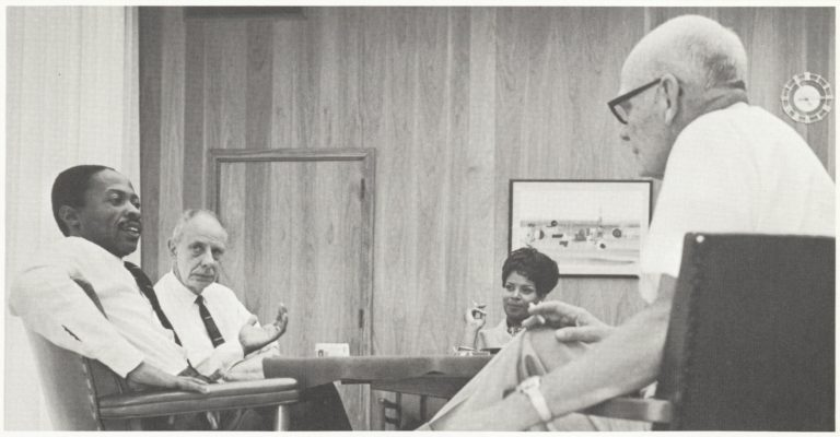 Roy Clay, the future Godfather of Silicon Valley speaking with other HP employees in 1968.